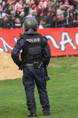Police officer control football fans to prevent football violence — Stock Photo