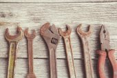 Old, rusty tools on wooden background — Foto Stock