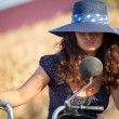 Portrait of fashion attractive girl with hat besides an old scooter — Stock Photo #68847793
