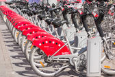 LYON, FRANCE - on APRIL 14, 2015 - Shared bikes are lined up in the streets of Lyons, France. Velo'v Grand Lyon has over 340 stations and 3000 bikes throughout the Grand Lyon area. — Stock Photo