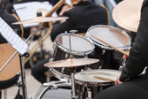 A drummer on the concert. close up process play on a drums — Stock Photo