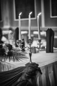 Vintage candlestick with burning candles on black and white — Stock Photo