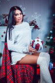 Beautiful Brunette on the Gackground of New Year's Decoration — Stock Photo