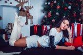 Beautiful Brunette on the Gackground of New Years Decoration — Stock Photo