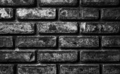 Old brick wall background in black and white — Stock Photo