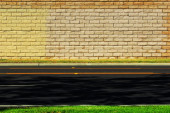 Empty road with brick wall background — Stock Photo