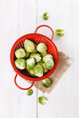 Brussels sprouts over rustic wooden background — Stock Photo