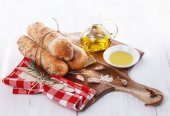 Freshly baked bread rolls and oil — Stock Photo