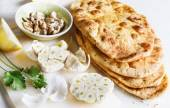 Pile of flat bread and spices on a table — Stock Photo