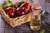 Apple cider vinegar over rustic wooden background — Stock Photo