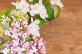 Spring flowers on a wooden background — Stock Photo