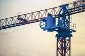 Cranes on a construction site — Stock Photo