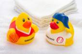 Two duck toys on the white towel — Stock Photo