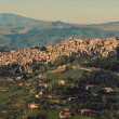 View of Calascibetta - vintage effect. Mediterranean city on the — Stock Photo #61879415