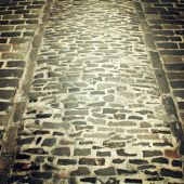 Old paving useful as a background - retro filter. — Stock Photo