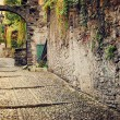 Deserted medieval street - vintage effect. Varenna, Como lake, Italy. — Stock Photo #63588677
