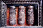 Metal drums inscribed with mantras — Stock Photo
