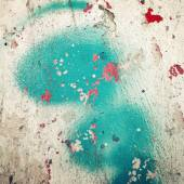 Green paint on concreat surface - toned filter. Red blotches. — Stock Photo