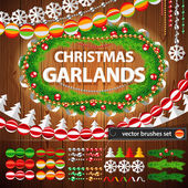 Christmas Garlands Set on Wood Background — Stock Vector