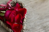 Close Up Wooden Heart with Rose and Petals — Stock Photo