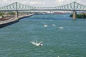 Boats beneath a bridge — Stock Photo