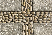 Pattern of hand-laid pebbles  — Stock Photo