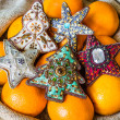 Christmas tree ornaments and oranges in sack — Stock Photo #58201221