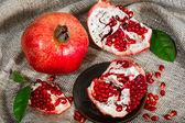 Pomegranate with broken segments — Stock Photo