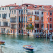 Venice, Italy - June 27, 2014: Evening view on colorful residential houses built directly on Grand Canal. View from Rialto bridge. — Stock Photo #63818253