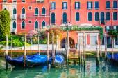 Venice, Italy - gondolas at pier on water canal — Fotografia Stock