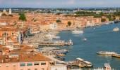 Venice, Italy - June 27, 2014: Cityscape of Venice - view from St. Mark's Campanile on quay and water buses moving on Grand Canal — Stock Photo