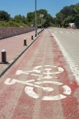 Red bike path at Menorca, Spain — Stock Photo