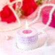 Romantic background - Aroma candle with red rose bouquet and pea — Stock Photo #80588480