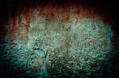 Bloody stain on dirty brick wall with vintage and vignette tone — Stock Photo