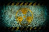Nuclear radiation warning symbol on grunge wall background — Stock Photo
