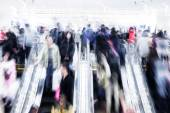 Motion blurred crowd people in shopping mall — Stock Photo
