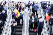 Motion blurred crowded people shopping in mall — Стоковое фото