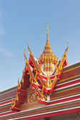 Thai Buddhist temple roof gable with tiered and carved apex — Стоковое фото