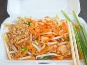 Closeup of Pad-Thai, Thai style stir fried noodle packed in carrying foam ware — Stock Photo