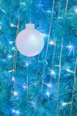 Ornamental electric light ball hanging on cristmas tree — Foto Stock