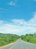 Local highway under blue sky — Stock Photo