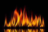 Yellow fire flames on a black — Stock Photo