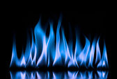 Blue fire flames on a black background — Stock Photo