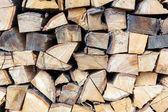 Background of dry chopped firewood logs in a pile — Stock Photo