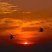 Mi-24 helicopters, warm sunset — Stock Photo