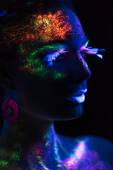 Sensual woman in fluorescent paint makeup — Stock Photo