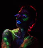 Red  light contour on the sensual woman with fluorescent paint makeup — Photo