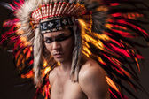 Indian strong man with traditional native american make up  — Photo