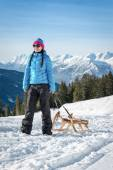 Young woman pulling a sledge — Stock Photo