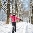 Young woman throwing a snowball — Foto de Stock   #62322339